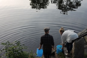 Collecting water from the local river Lagan, for the rake firing.